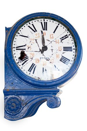 old and damaged retro clock with roman numeral from an abandoned train station photo