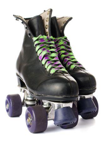 to skate: Retro patines aisladas sobre fondo blanco Foto de archivo