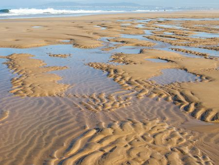 ripple effect: sand ripples in a beach in summer  Stock Photo