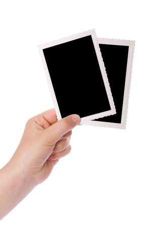 Hands holding a photograph isolated on a white background photo