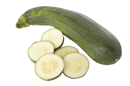 courgettes: Ripe zucchinis or courgettes isolated on a white background