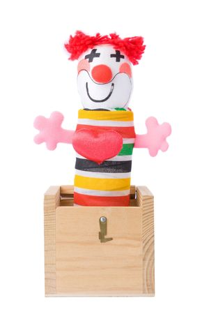 jack in a box: Jack-in-the-box toy isolated on a white background  Stock Photo