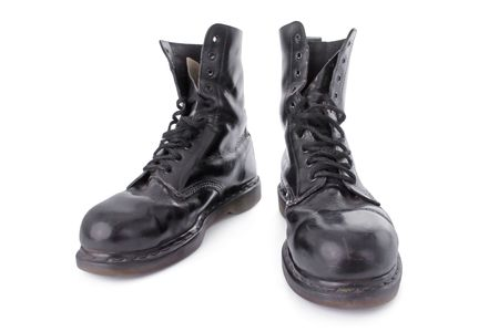skinhead: Old black leather work boots isolated on white background
