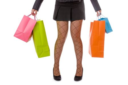 Tired young attractive woman carrying several shopping bags photo