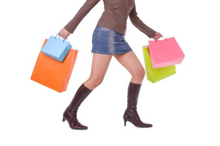 Young attractive woman running and carrying several shopping bags photo