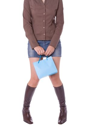 Tired or shy young attractive woman carrying a shopping bag photo