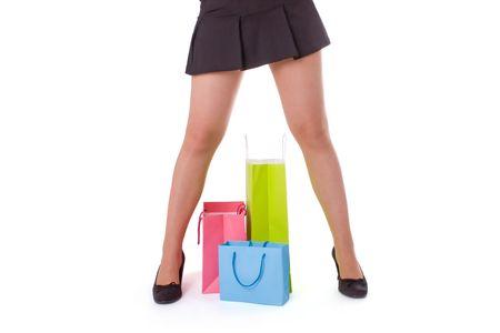 beine spreizen: Young attractive Woman mit mehreren Shopping bags