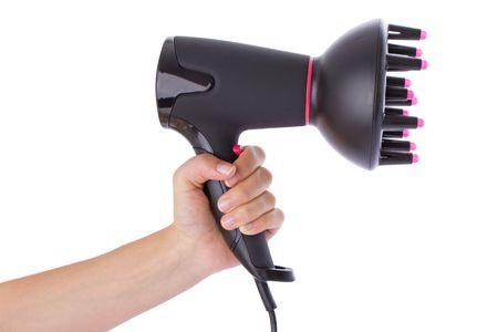 hairdryer: Hand holding a hairdryer isolated on a white background
