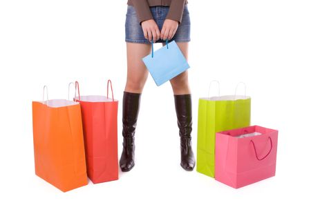 Young attractive woman with several shopping bags  photo