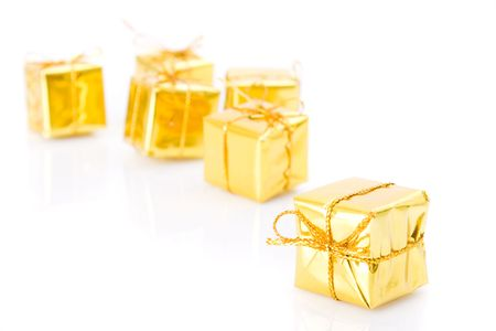 Small golden gifts isolated on white background  photo