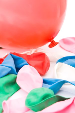inflated: Colorful balloons piled with one inflated and the other empty Stock Photo