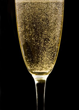 Flute with sparkling champagne against black background Archivio Fotografico