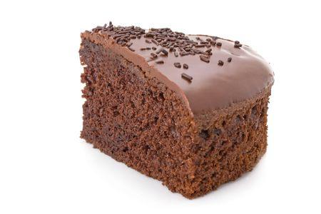 Slice of chocolate fudge cake with sprinkles detail on white  Archivio Fotografico