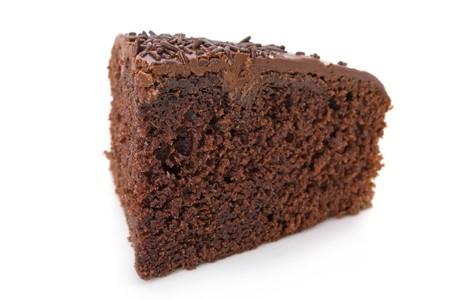 jimmies: Slice of chocolate fudge cake with sprinkles detail on white