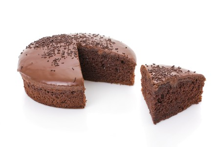 jimmies: Sliced chocolate fudge cake isolated on white background
