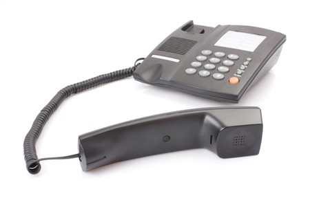 Black office telephone off hook isolated on white background photo