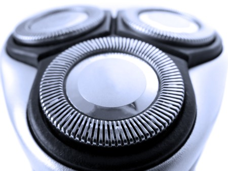 electric razor: Close up of the head of a modern electric razor Stock Photo