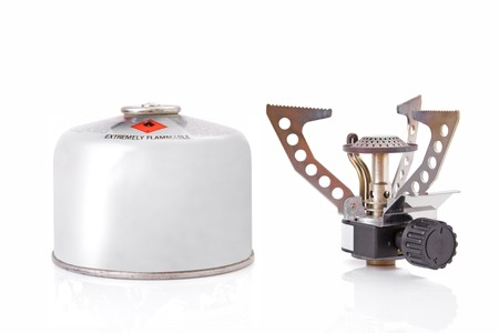 portable camping stove with a butanepropane gas canister photo