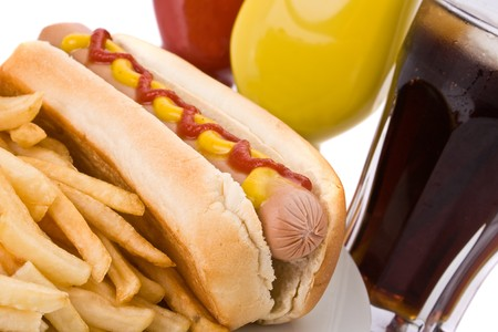 Fast food meal with hotdog, French fries and a cola