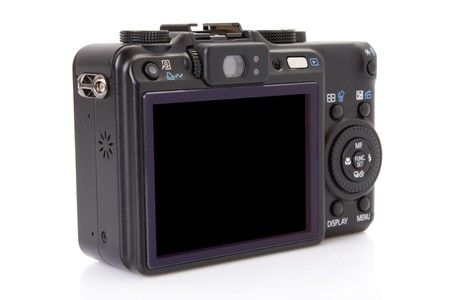 back of black digital compact camera isolated on white  photo