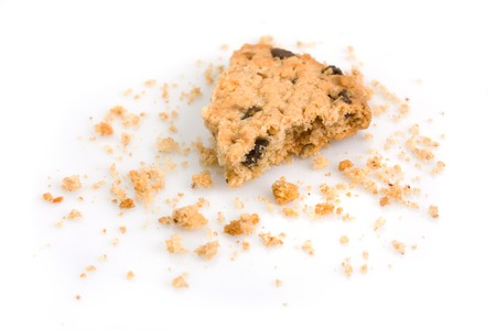 chocolate biscuit: Last bite of a chocolate chip cookie with crumbs Stock Photo