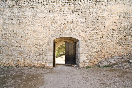 Open medieval castle gate in a fortified wall Stock Photo