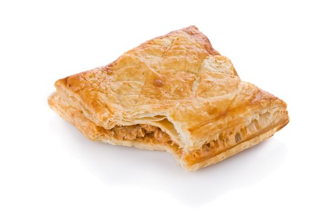 Puff pastry with tuna and tomato stuffing isolated on white background photo