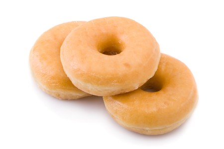 Three doughnuts or donuts piled isolated on white photo