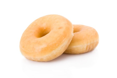 glaze: Two doughnuts or donuts piled isolated on white