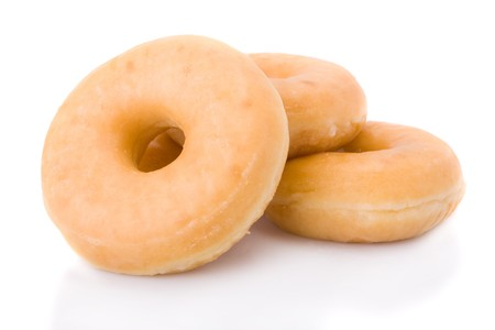 Three doughnuts or donuts piled isolated on white