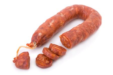 Sliced Iberian chorizo, from Barrancos - Alentejo region, Portugal (Chouri�o) - isolated on white  Stock Photo - 4431943