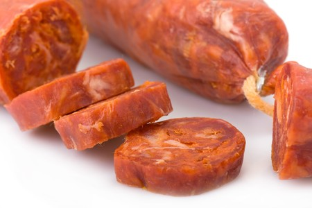 Sliced Iberian chorizo, from Barrancos - Alentejo region, Portugal (Chouriço)  Stock Photo
