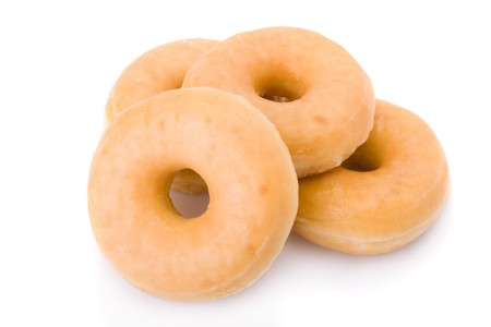 piled: Four doughnuts or donuts piled isolated on white Stock Photo