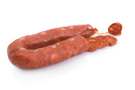 Sliced Iberian chorizo, from Barrancos - Alentejo region, Portugal (Chourico) - isolated on white  photo