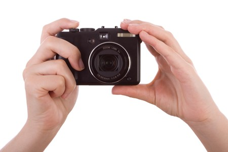 grabbing hand: Hands photographic with a digital camera isolated on white Stock Photo