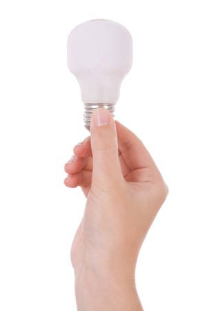 incandescent: Hand holding an incandescent light bulb isolated on white