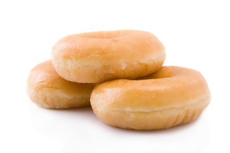 sugary: Three doughnuts or donuts piled isolated on white