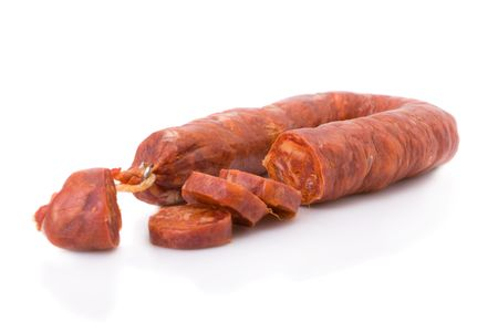 Sliced Iberian chorizo, from Barrancos - Alentejo region, Portugal (Chouri�o) - isolated on white photo