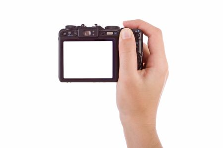 grabbing at the back: Hand photographing with a digital camera isolated on white