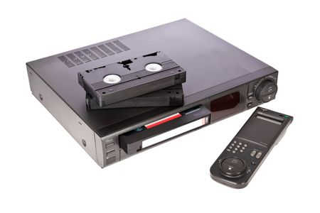 vcr: Old Video Cassette Recorder and tapes isolated on white background