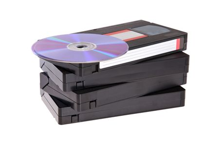 Old Video Cassette tapes with DVD discs isolated on white background Stock Photo