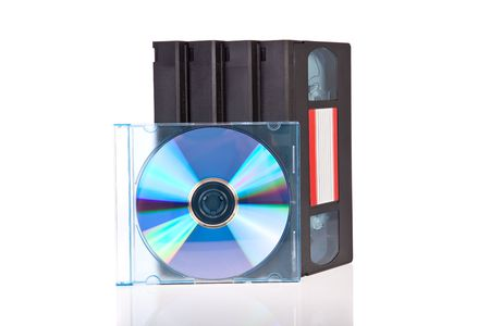 Old Video Cassette tapes with a DVD disc isolated on white background photo