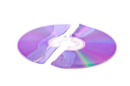 dvdr: Shattered DVD  CD isolated on a white background Stock Photo