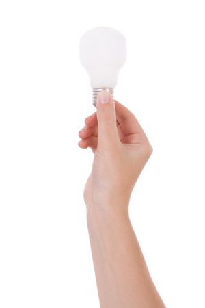 grabbing: Hand holding an incandescent light bulb isolated on white