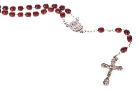 entangled: Rosary beads isolated over a white background Stock Photo