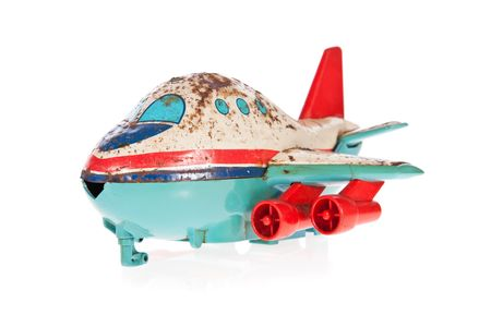 Old Jet plane rusty tin toy isolated on white Stock Photo - 6647937