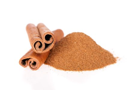 stick of cinnamon: Cinnamon powder and sticks isolated on a white background
