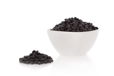 turtle bean: Black turtle beans in a bowl isolated on a white background
