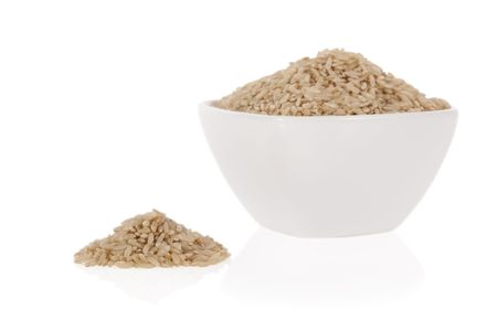 Brown rice in a bowl isolated on a white background Stock Photo - 6918979