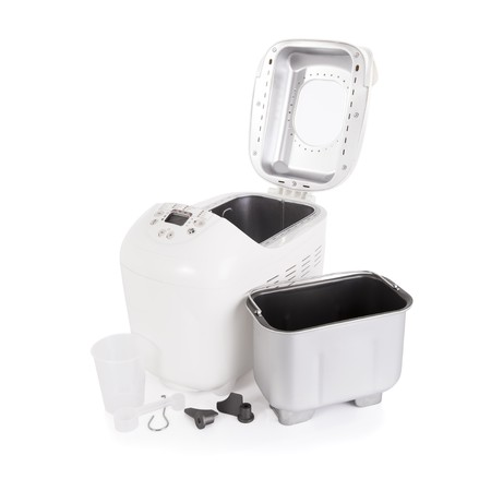 Breadmaker and accessories isolated on a white background photo